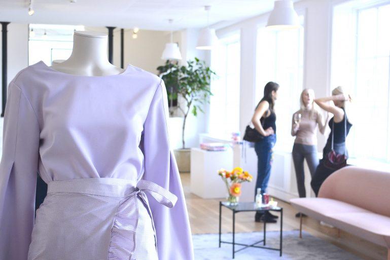 open press day showroom mannequin robe